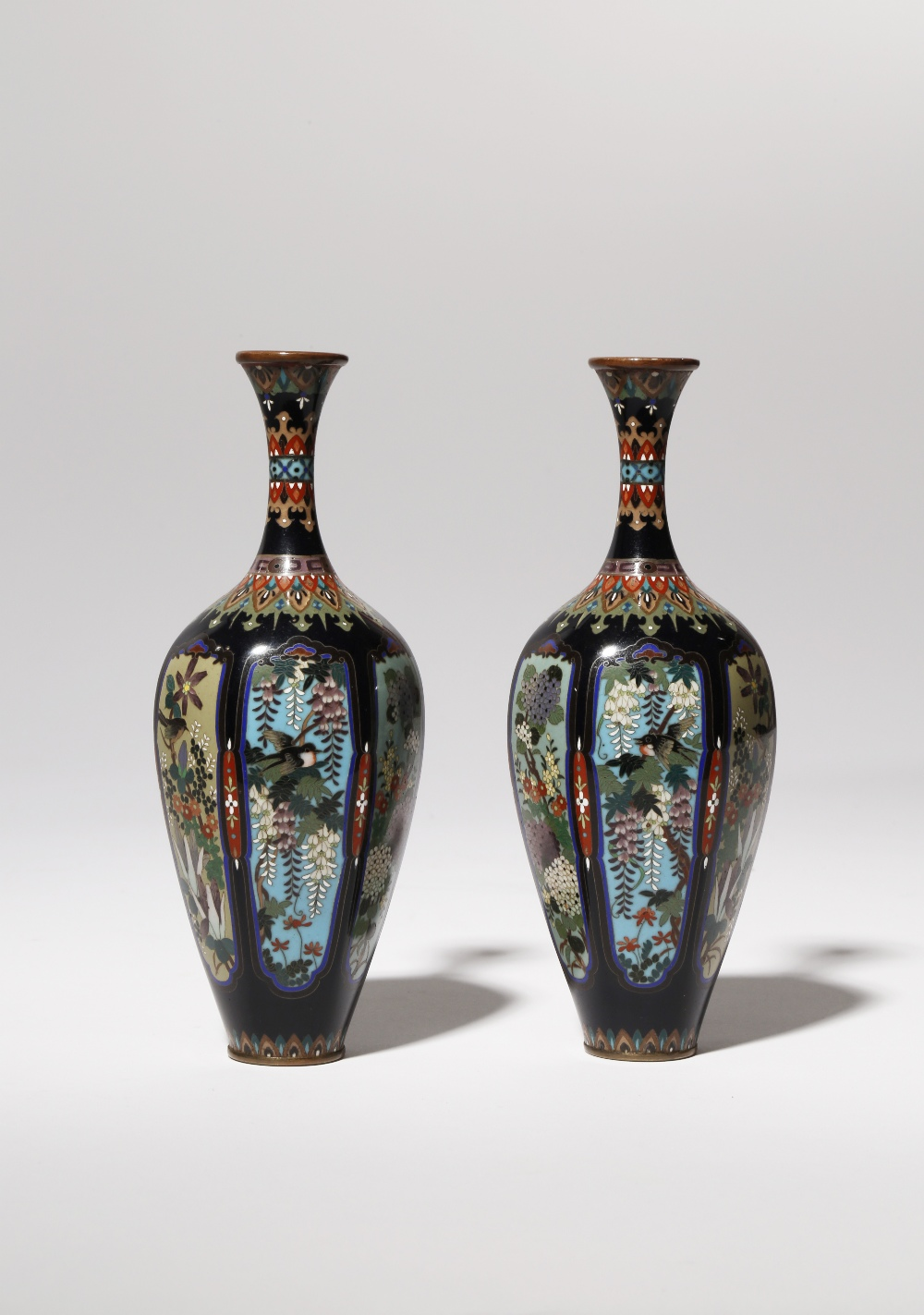 A PAIR OF JAPANESE CLOISONNE VASES BY OTA KICHISABURO MEIJI PERIOD, 19TH OR 20TH CENTURY The tall