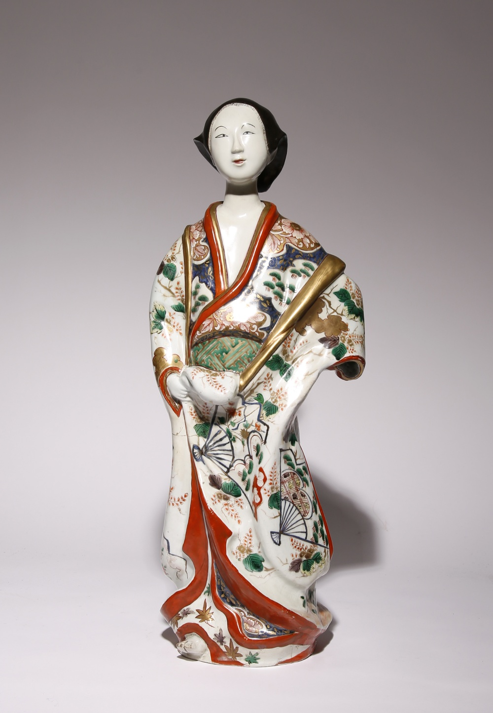 A LARGE JAPANESE IMARI FIGURE OF A BIJIN EDO PERIOD, 18TH CENTURY The elegant figure smiles gently