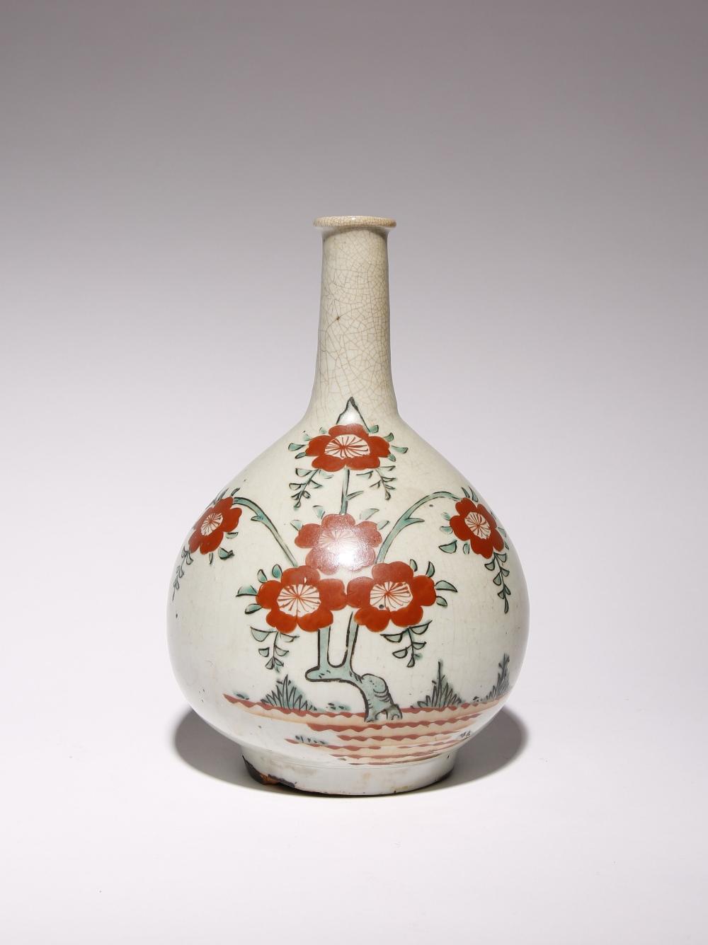 A JAPANESE ARITA BOTTLE VASE EDO PERIOD, 17TH OR 18TH CENTURY Possibly Ko-Imari, the bulbous body