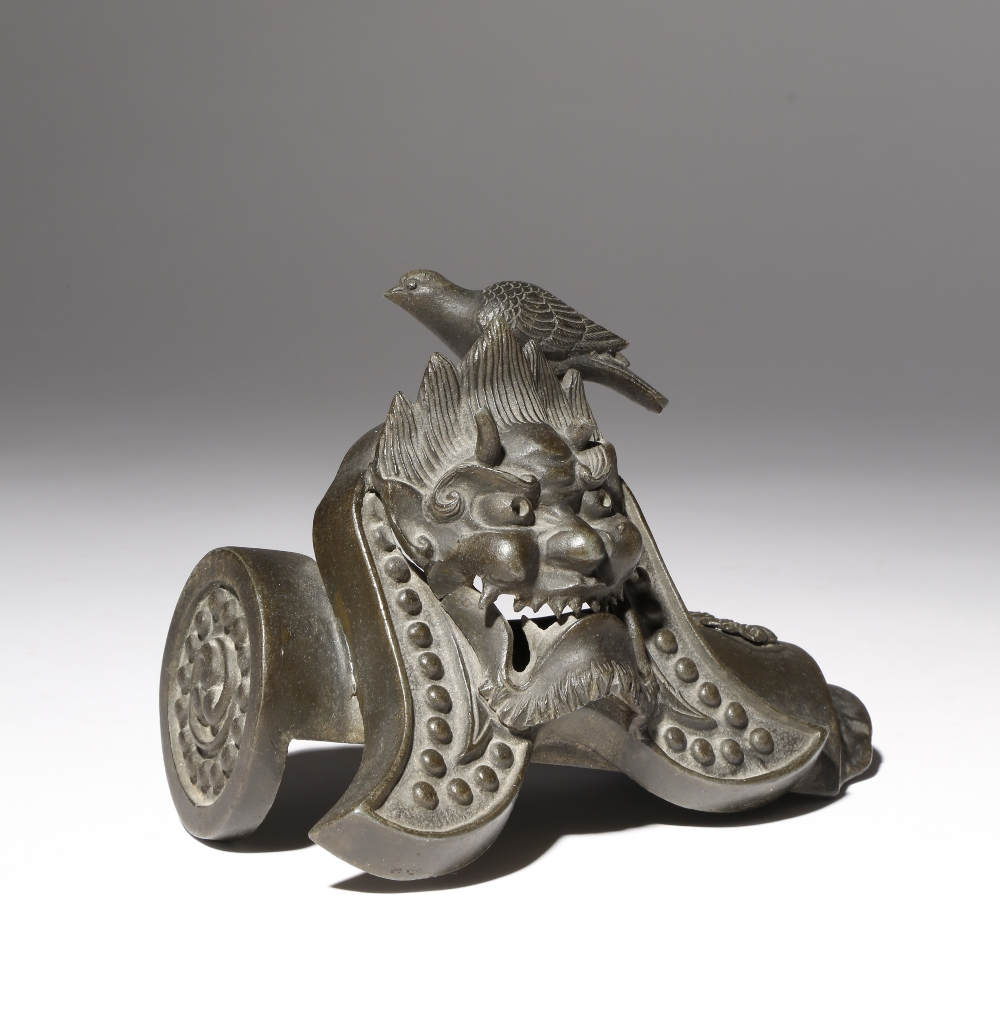 A JAPANESE BRONZE OKIMONO OF A DOVE ON A ROOF TILE MEIJI PERIOD, 19TH CENTURY The bird perched on an