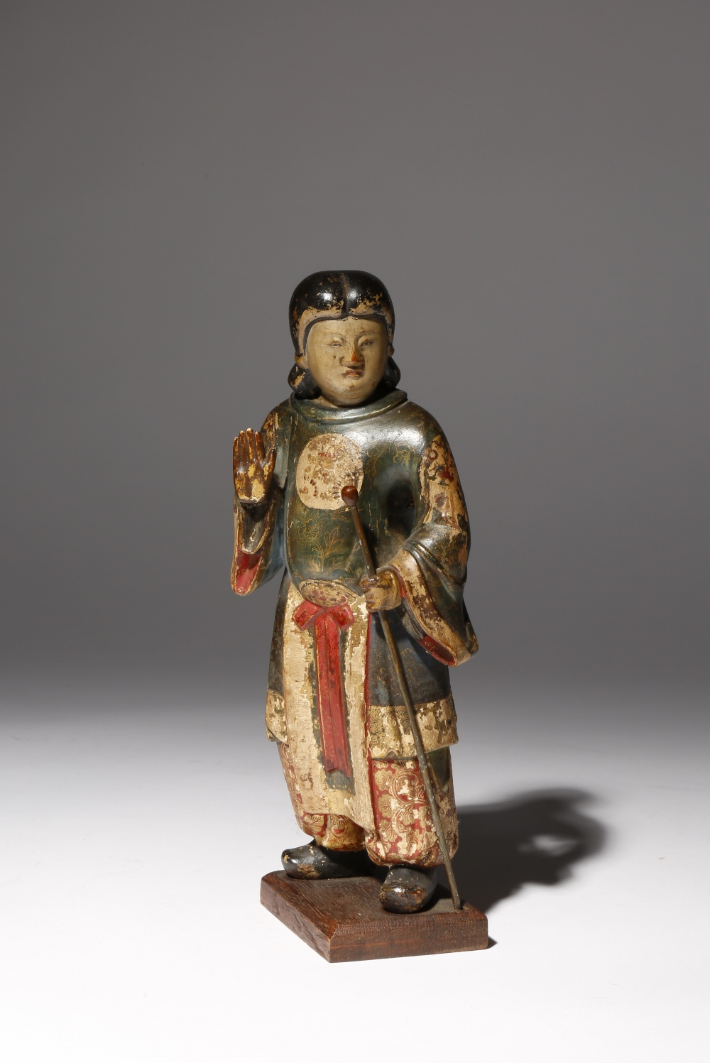 A RARE JAPANESE POLYCHROME LACQUERED WOOD CARVING OF A PROTECTIVE DEITY EDO PERIOD, PROBABLY 18TH