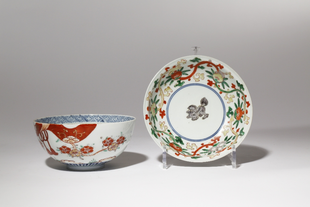 TWO JAPANESE IMARI BOWLS EDO PERIOD, 18TH CENTURY The first with a shallow body decorated in