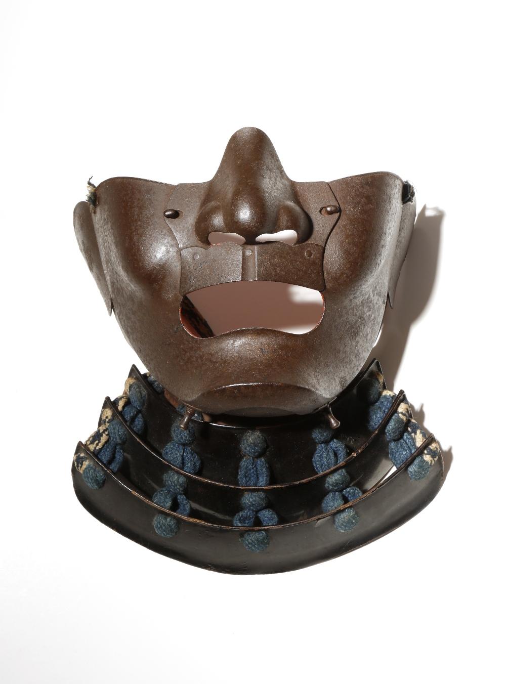 A JAPANESE IRON BIJO MEN MENPO EDO PERIOD, 19TH CENTURY The iron mask with elegant features in the