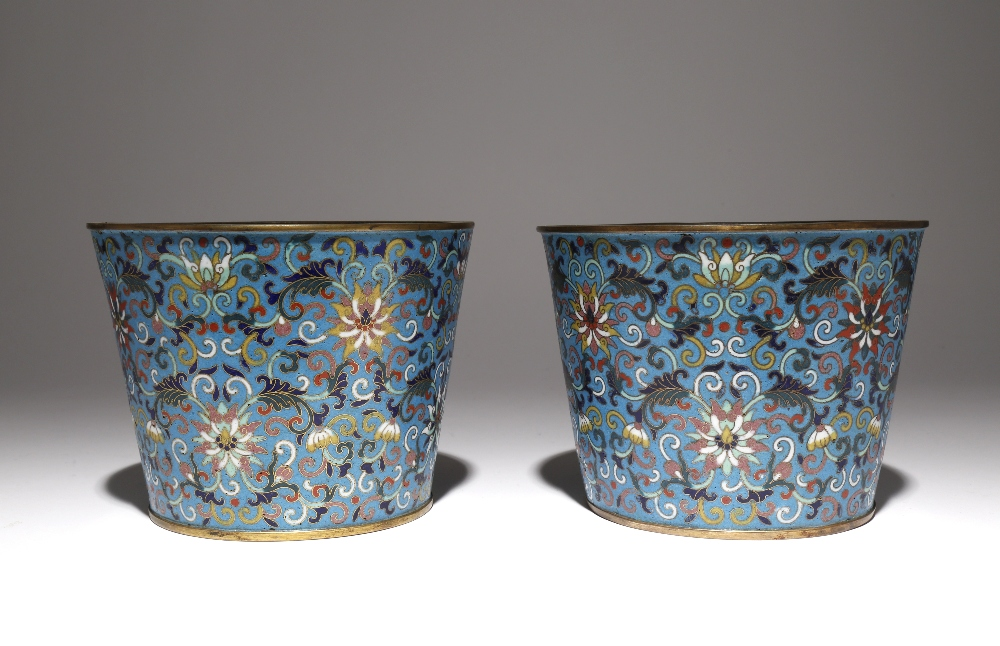 A PAIR OF CHINESE CLOISONNE 'LOTUS' JARDINIERES LATE QING DYNASTY Each with a gently flared body,