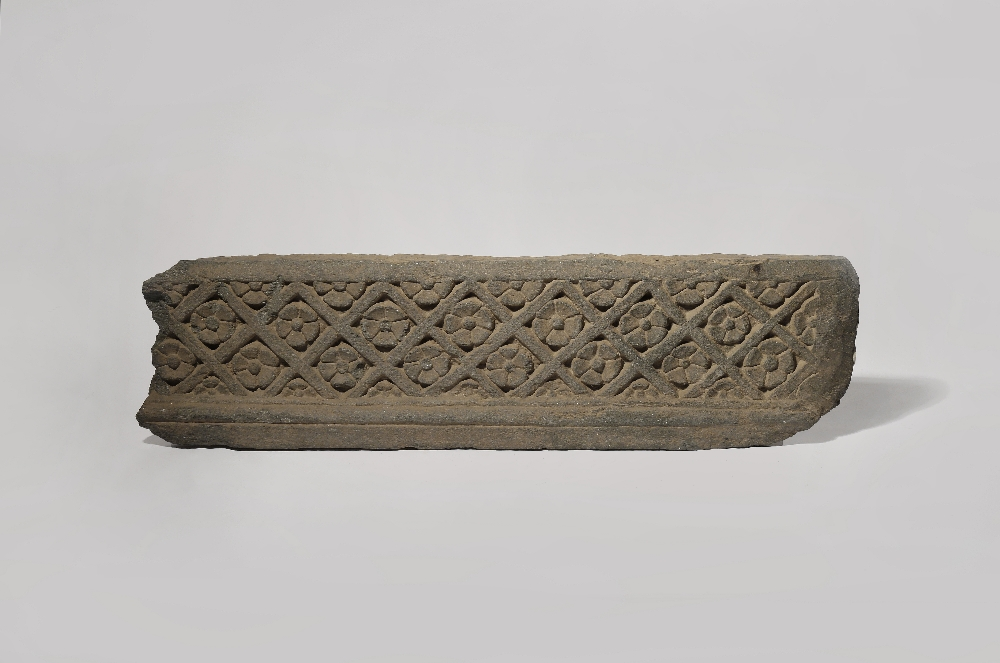 A GANDHARAN GREY SCHIST FRAGMENT OF A FRIEZE 1ST/2ND CENTURY AD One side carved in relief with a