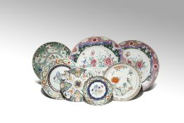 SEVEN CHINESE ENAMELLED PORCELAIN PLATES 18TH CENTURY Comprising: two large famille rose plates