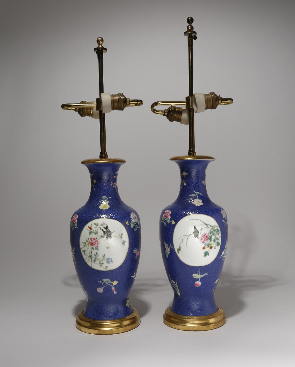 A PAIR OF CHINESE FAMILLE ROSE BLUE-GROUND VASES LATE QING DYNASTY/REPUBLIC PERIOD The ovoid