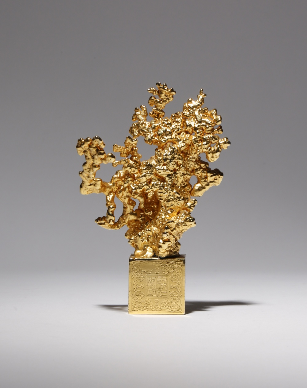 A CHINESE GILT-METAL SCULPTURE BY ZHU BINGREN (B.1944) CONTEMPORARY Naturalistically formed as a