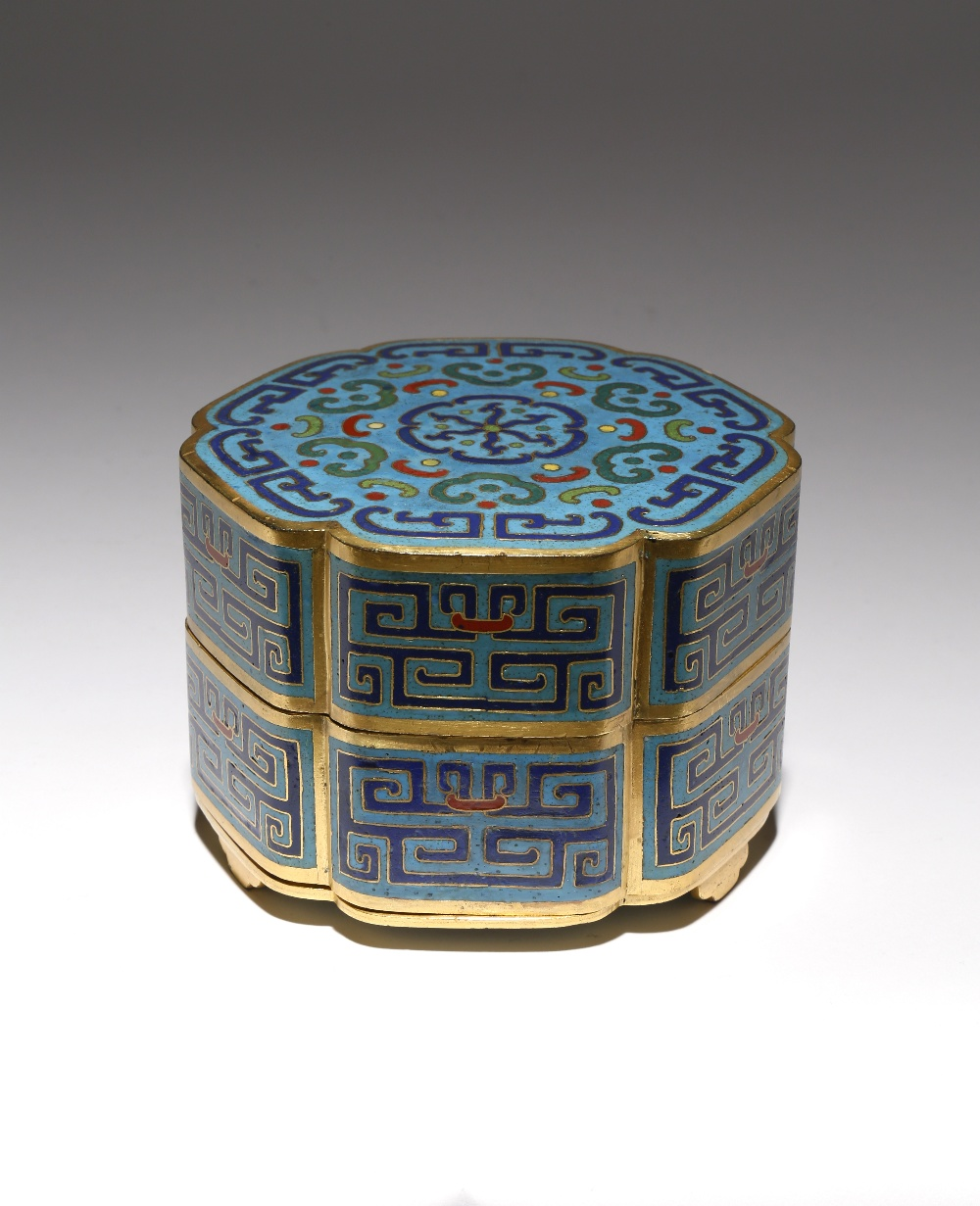 A CHINESE CLOISONNE TWO-TIERED LOBED BOX AND COVER QING DYNASTY OR LATER Shaped as a flowerhead, the