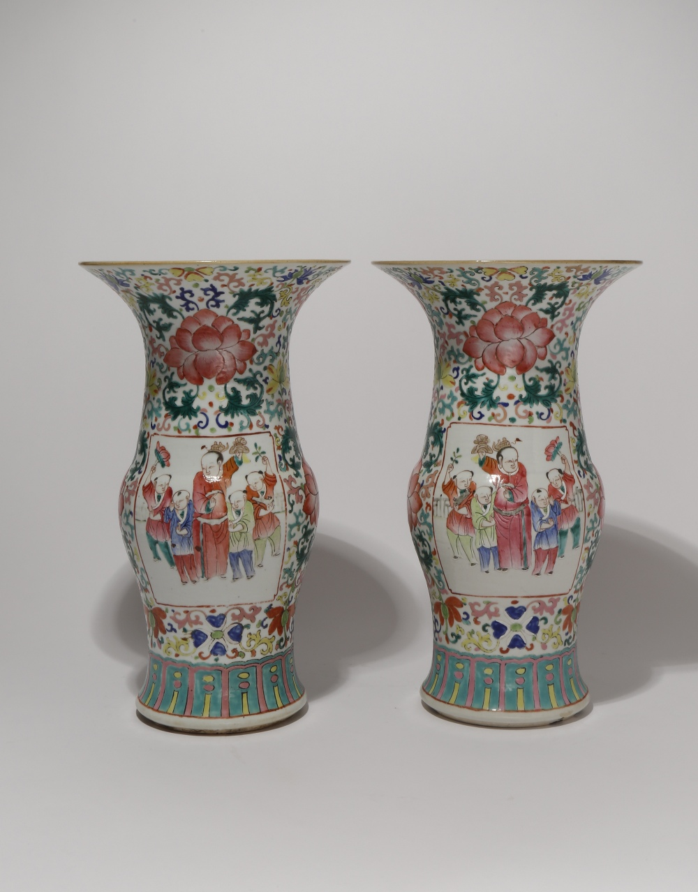 A PAIR OF CHINESE FAMILLE ROSE 'BOYS' VASES 19TH CENTURY Each painted with two rectangular panels