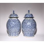 A NEAR PAIR OF LARGE CHINESE BLUE AND WHITE 'PEONY' BALUSTER VASES AND COVERS QING DYNASTY Each