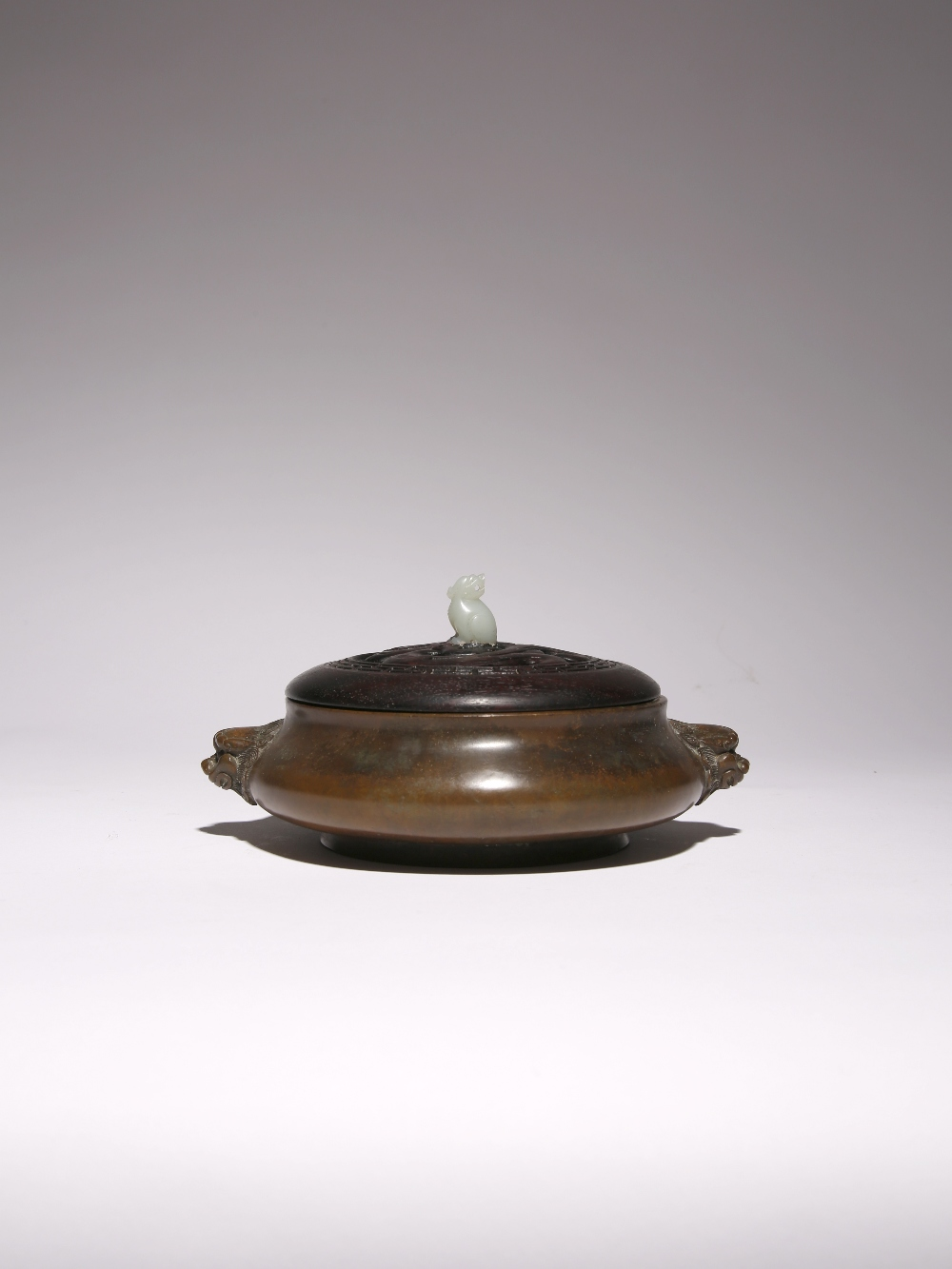 A CHINESE BRONZE INCENSE BURNER PROBABLY LATE QING DYNASTY The bombé-shaped body cast with two