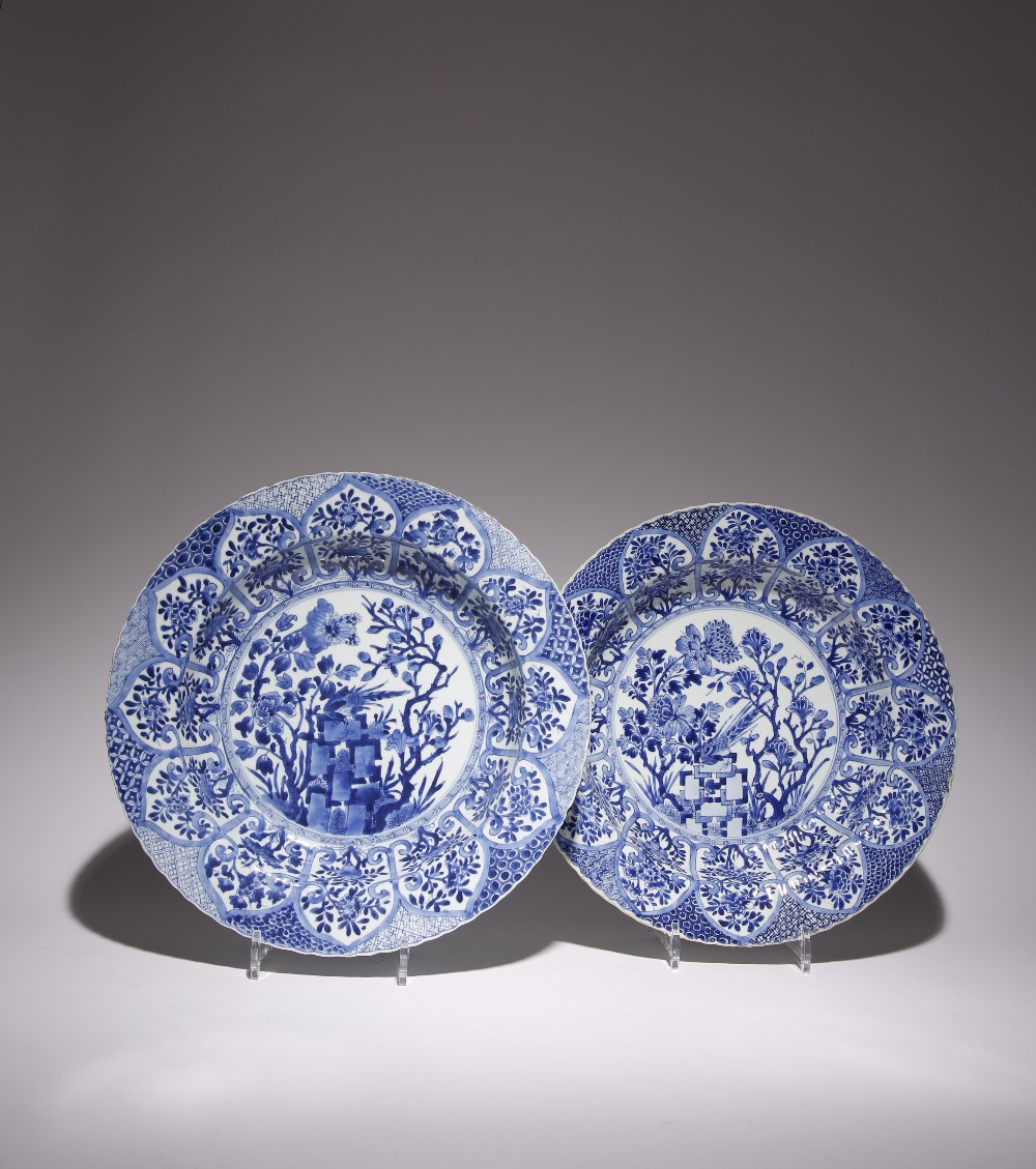 A NEAR PAIR OF LARGE CHINESE BLUE AND WHITE MOULDED 'PHEASANT' DISHES KANGXI 1662-1722 Each