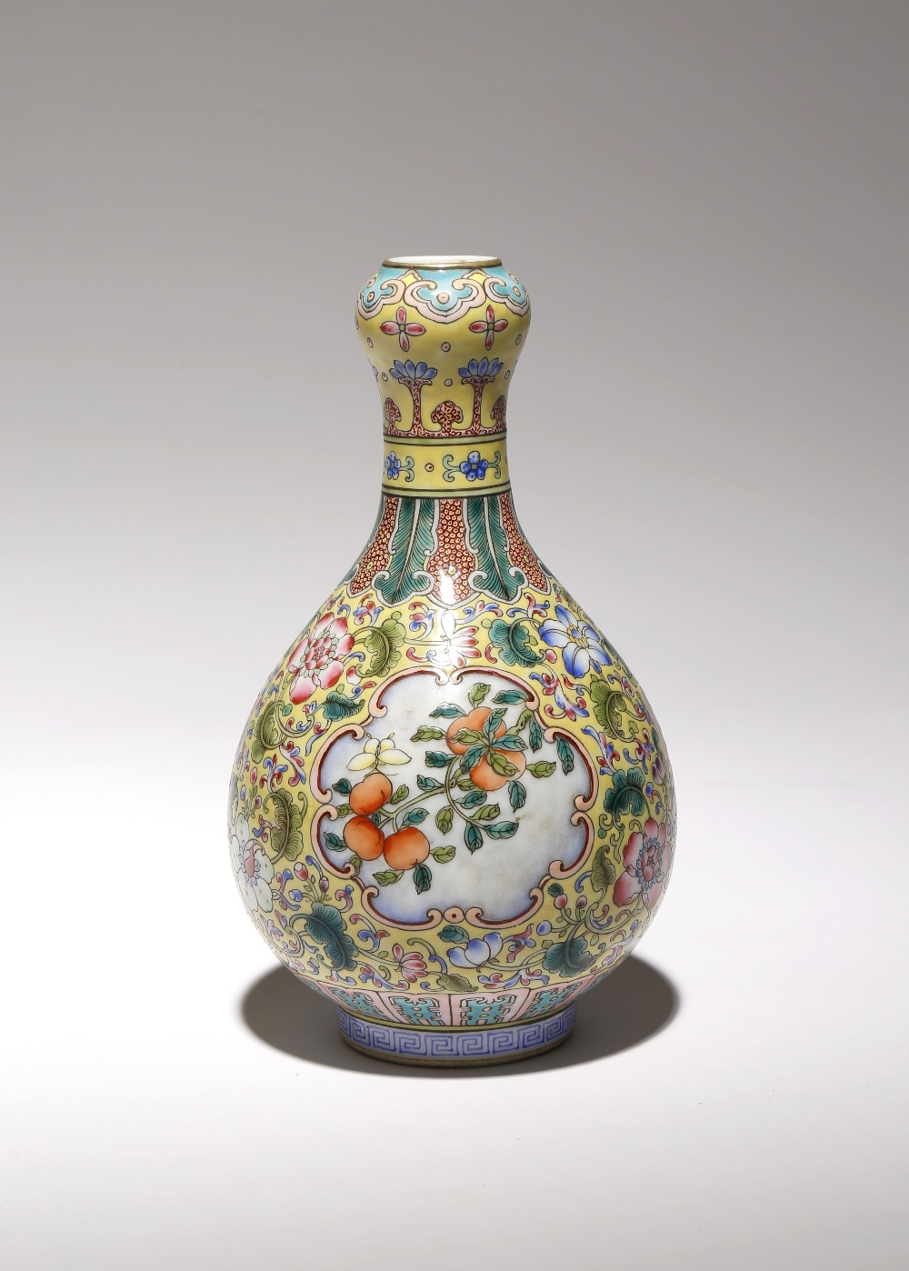 A CHINESE FAMILLE ROSE YELLOW-GROUND GARLIC-MOUTH BOTTLE VASE REPUBLIC PERIOD OR LATER The pear-