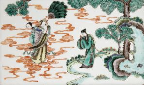 A CHINESE FAMILLE VERTE RECTANGULAR PLAQUE 19TH/EARLY 20TH CENTURY Painted with an official in a