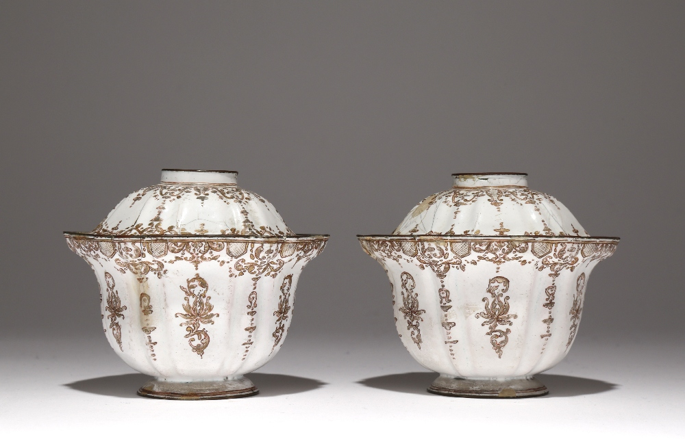 A PAIR OF CHINESE CANTON ENAMEL BOWLS AND COVERS 18TH CENTURY With lobed bodies and foliate rims,