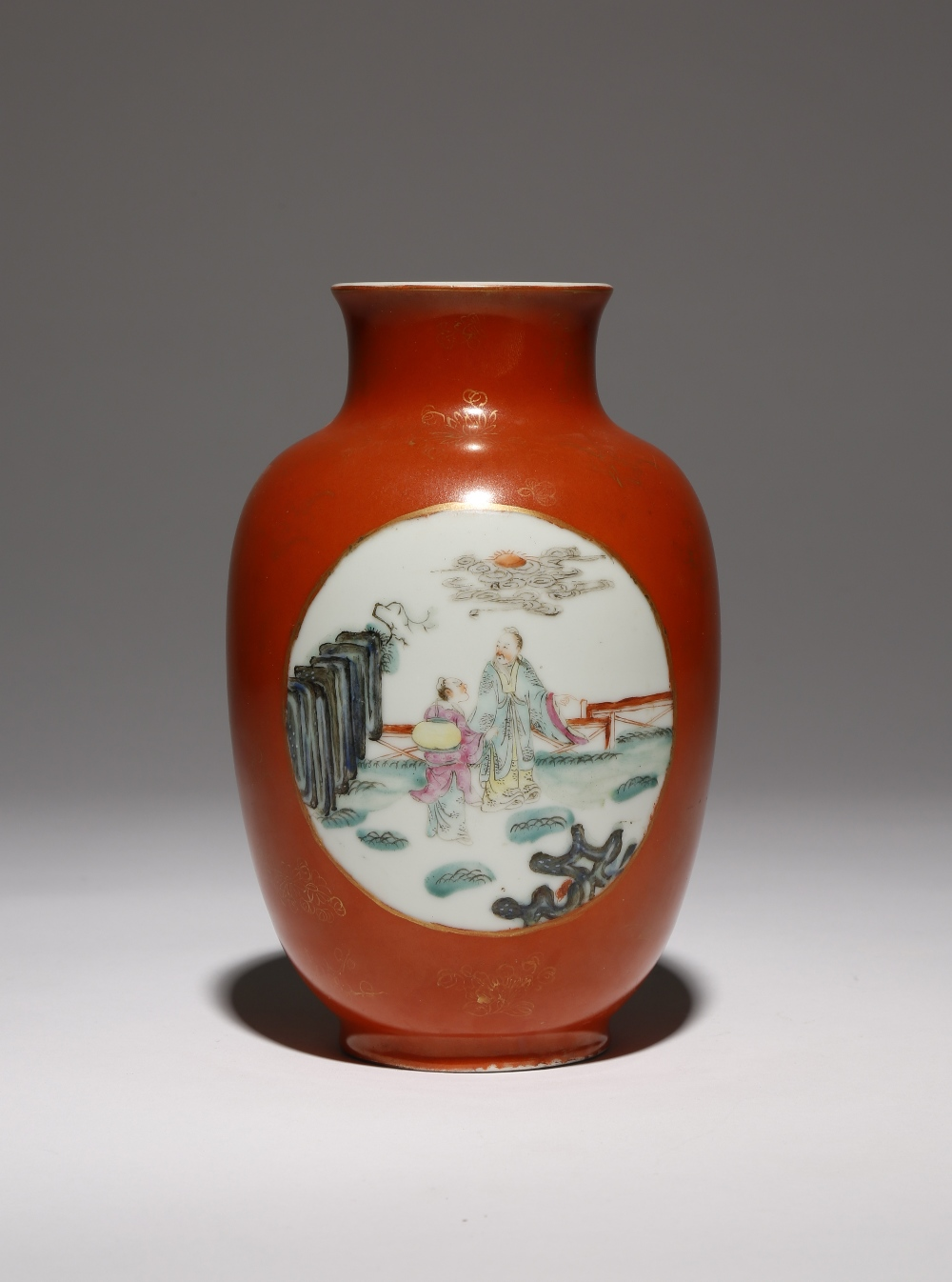 A CHINESE FAMILLE ROSE CORAL-GROUND OVOID VASE 19TH CENTURY Painted in enamels with two roundels