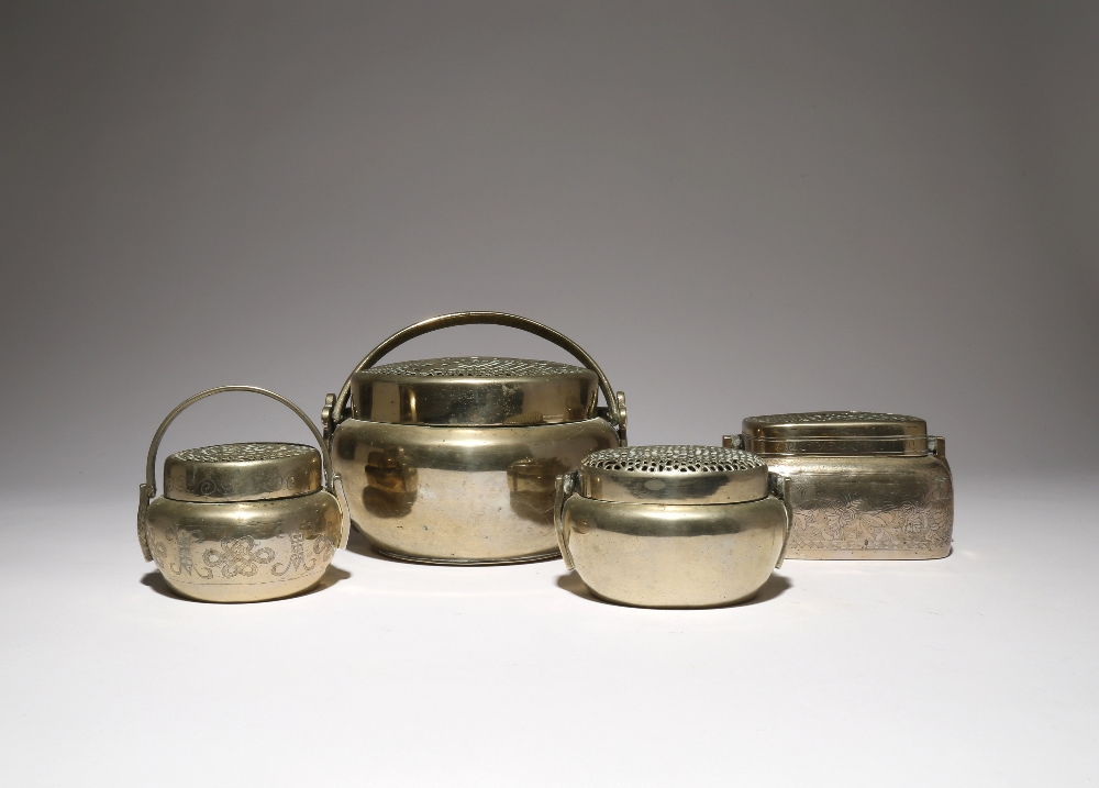 FOUR CHINESE BAITONG HAND WARMERS AND COVERS QING DYNASTY One with a rectangular-section body