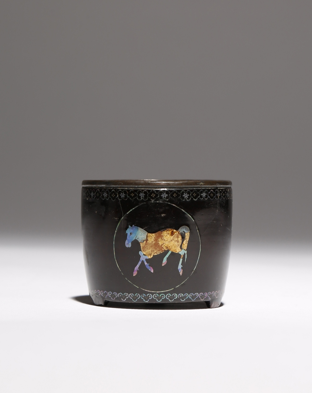 A SMALL CHINESE MOTHER OF PEARL INLAID LACQUER BOWL 18TH CENTURY Raised on three short feet,