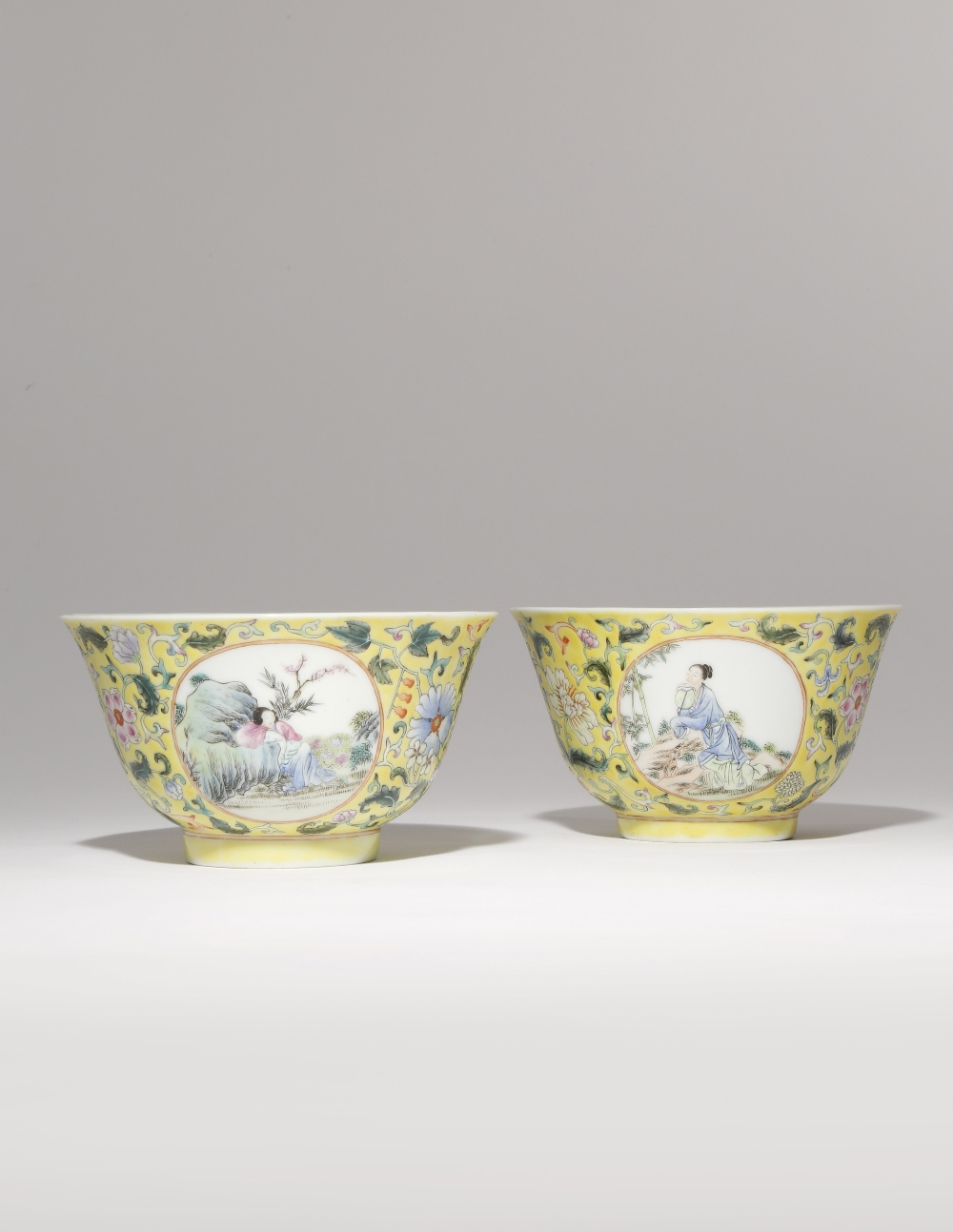 A PAIR OF CHINESE FAMILLE ROSE YELLOW-GROUND MEDALLION BOWLS LATE QING DYNASTY Each painted with