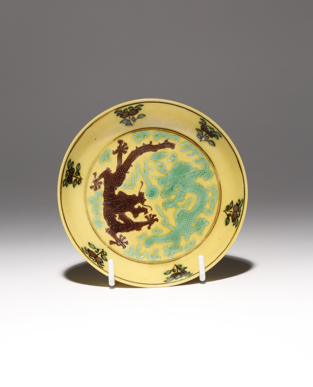 A CHINESE IMPERIAL YELLOW-GROUND 'DRAGON' SAUCER DISH SIX CHARACTER GUANGXU MARK AND OF THE PERIOD