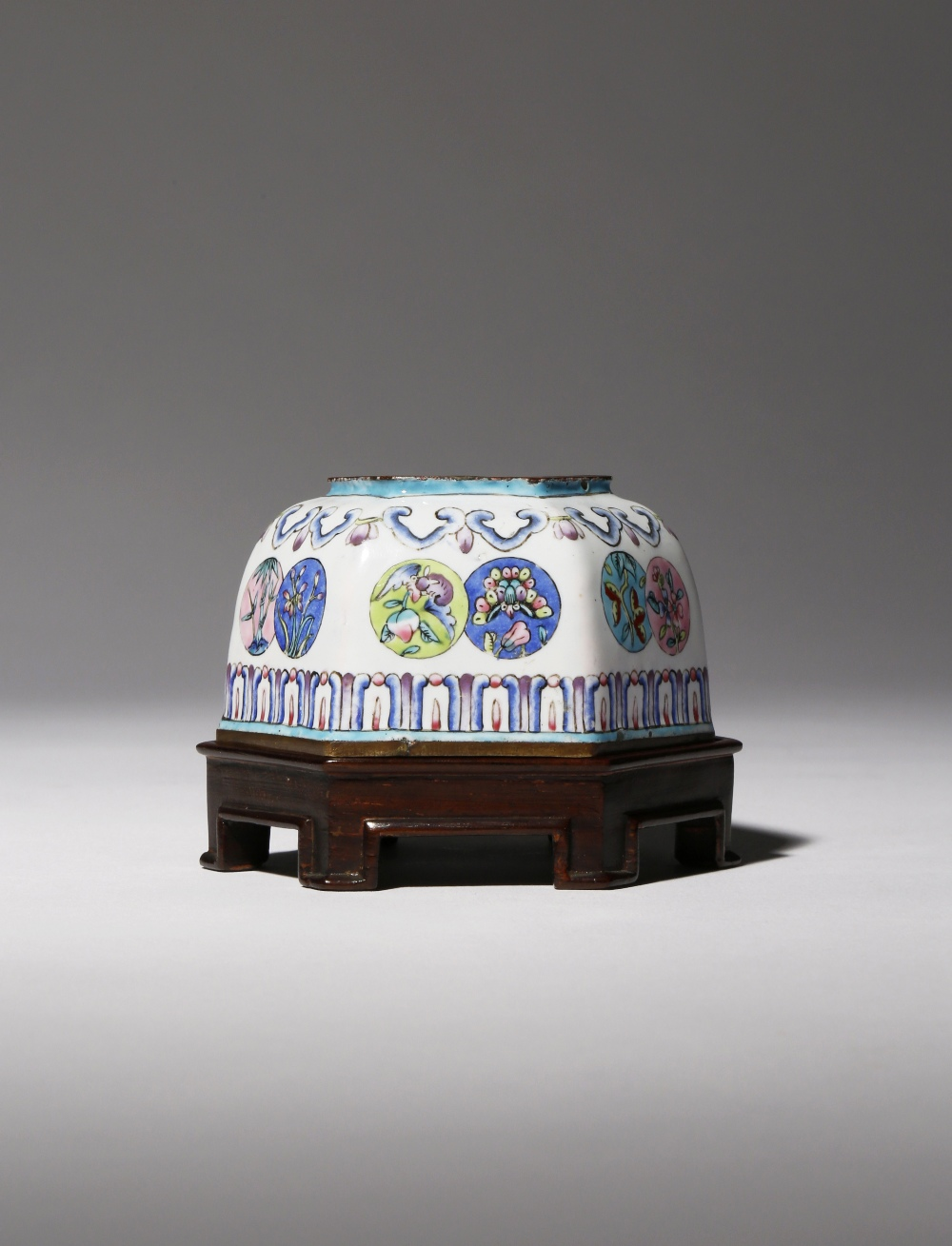 A CHINESE FAMILLE ROSE CANTON ENAMEL HEXAGONAL-SECTION WATERPOT 18TH CENTURY Each facet decorated