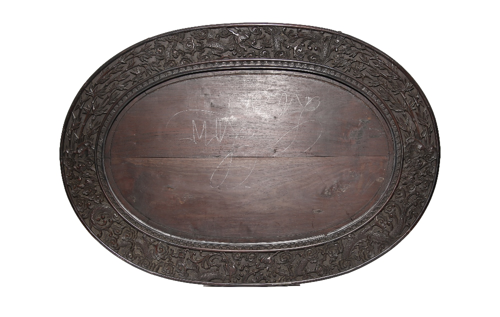 A MASSIVE CHINESE HARDWOOD OVAL 'DRAGON' FRAME QING DYNASTY Carved in relief to the edges with