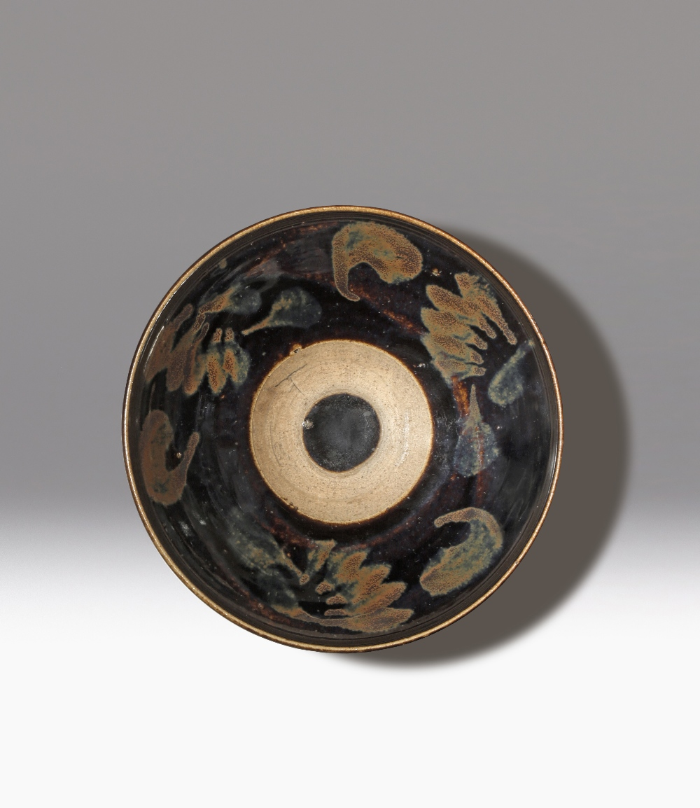 A CHINESE JIZHOU-TYPE BLACK GLAZED BOWL SONG DYNASTY The sides moulded with two continuous raised