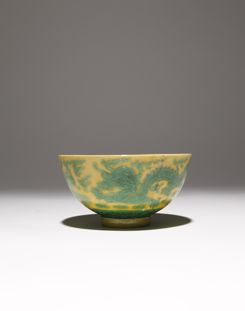 A CHINESE IMPERIAL GREEN-ENAMELLED YELLOW-GROUND 'DRAGON AND PHOENIX' BOWL SIX CHARACTER DAOGUANG