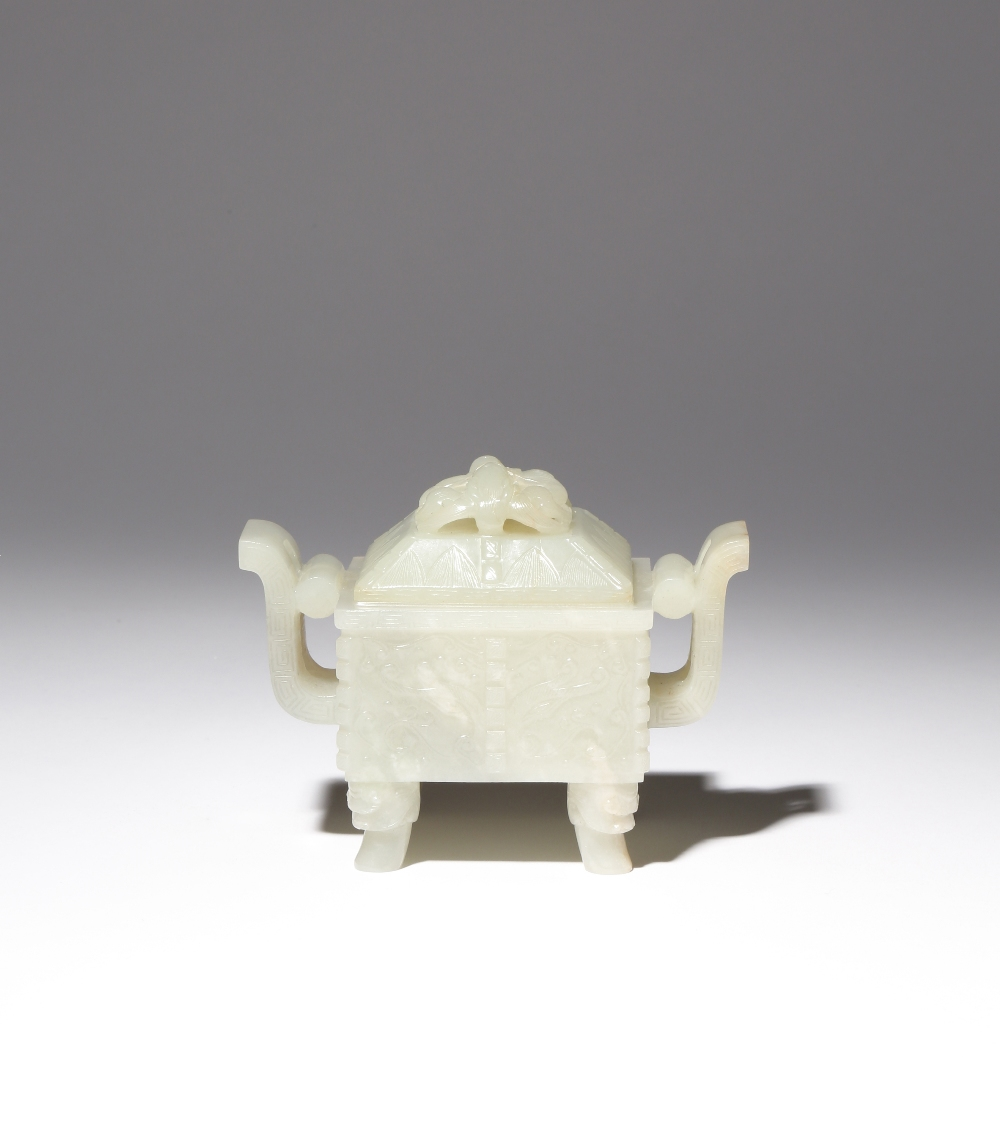 A CHINESE ARCHAISTIC PALE CELADON JADE INCENSE BURNER AND COVER, DING QING DYNASTY The rectangular-