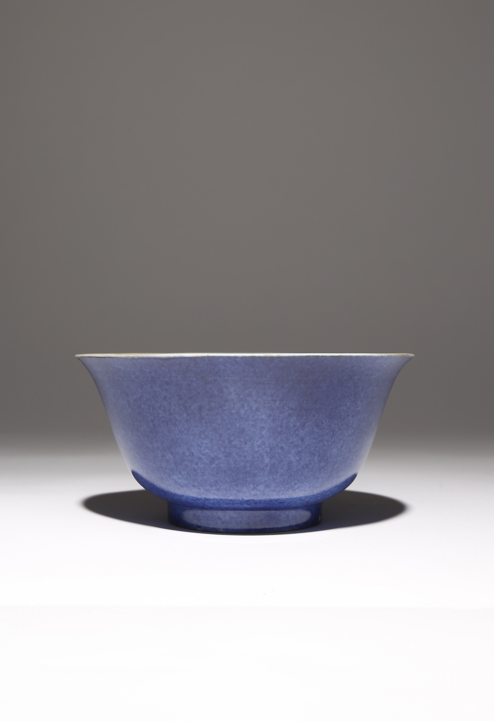 A CHINESE POWDER BLUE GLAZED BOWL KANGXI 1662-1722 The U-shaped body rising from a short straight