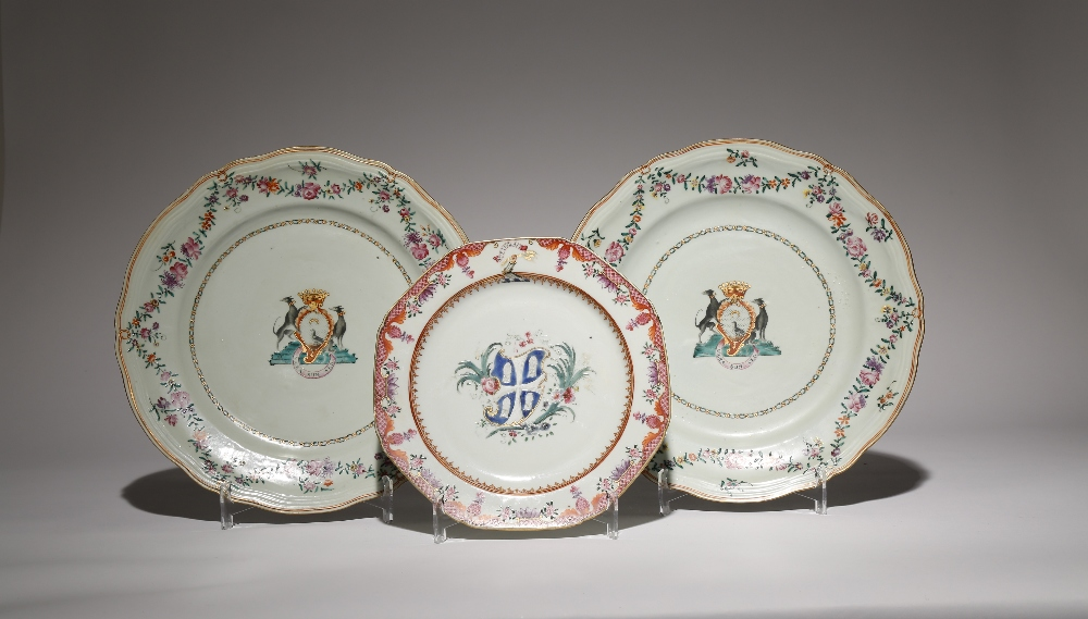 THREE CHINESE FAMILLE ROSE ARMORIAL PLATES 18TH CENTURY The two larger plates a pair, each painted