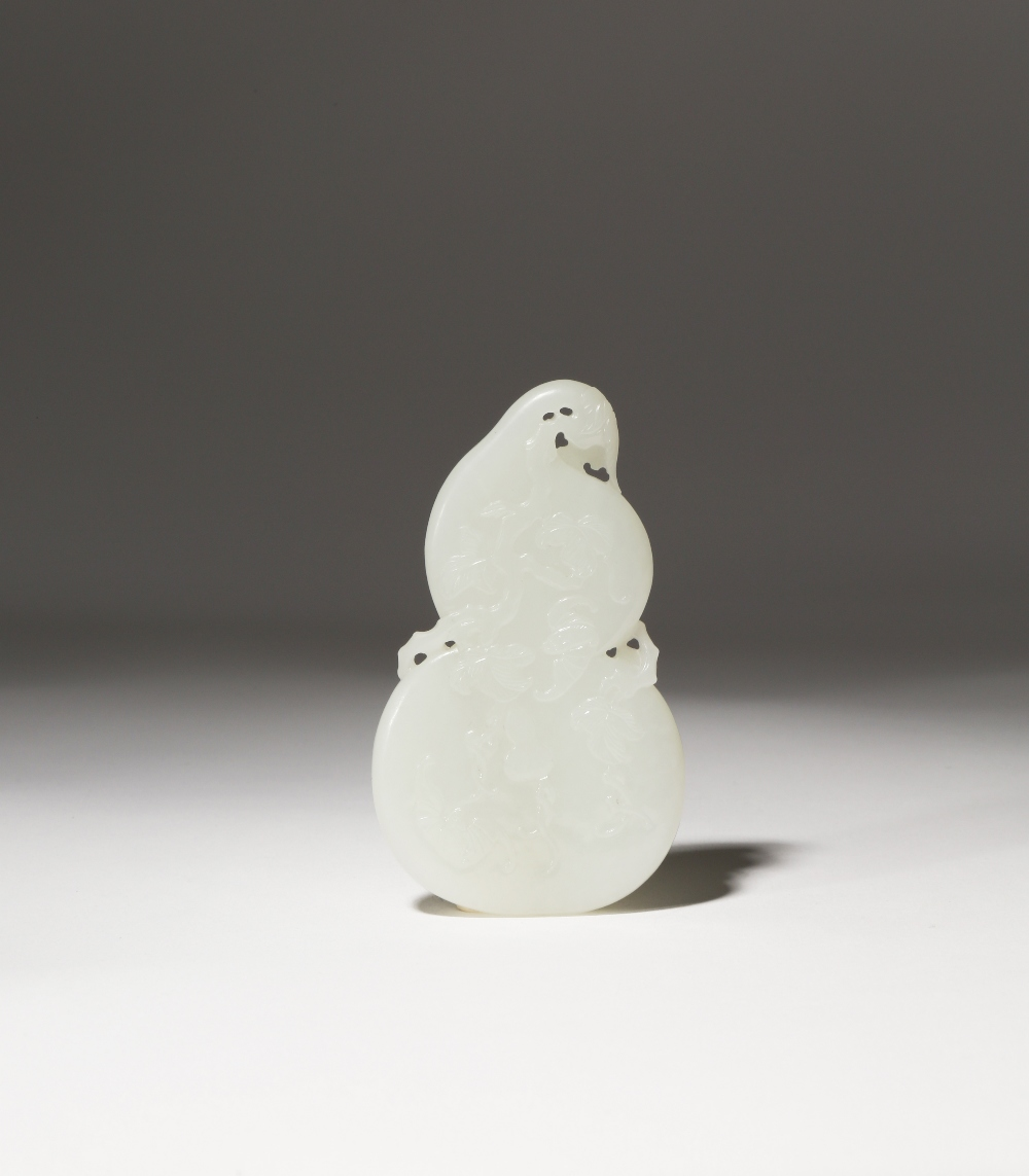 A CHINESE WHITE JADE 'GOURD' PENDANT QING DYNASTY OR LATER Formed as a large flattened gourd, carved
