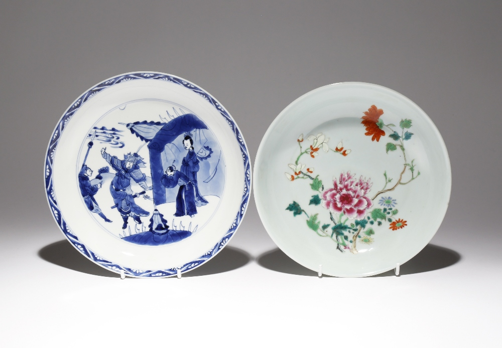 A CHINESE BLUE AND WHITE DISH AND A FAMILLE ROSE DISH QING DYNASTY The Kangxi blue and white dish