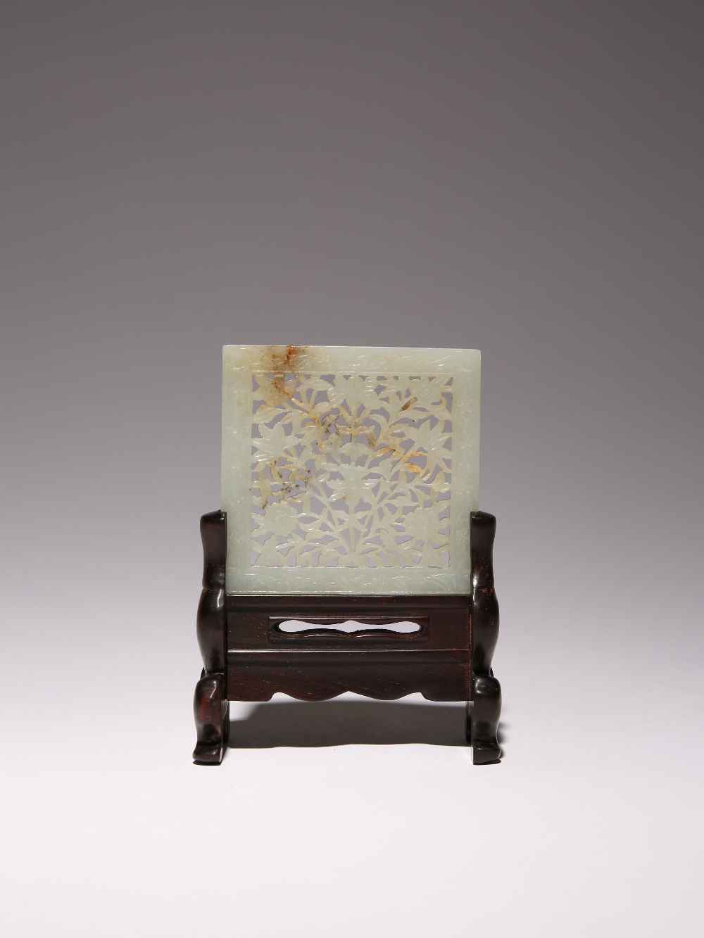 A CHINESE PALE CELADON JADE RECTANGULAR PLAQUE QING DYNASTY OR LATER Carved in openwork with