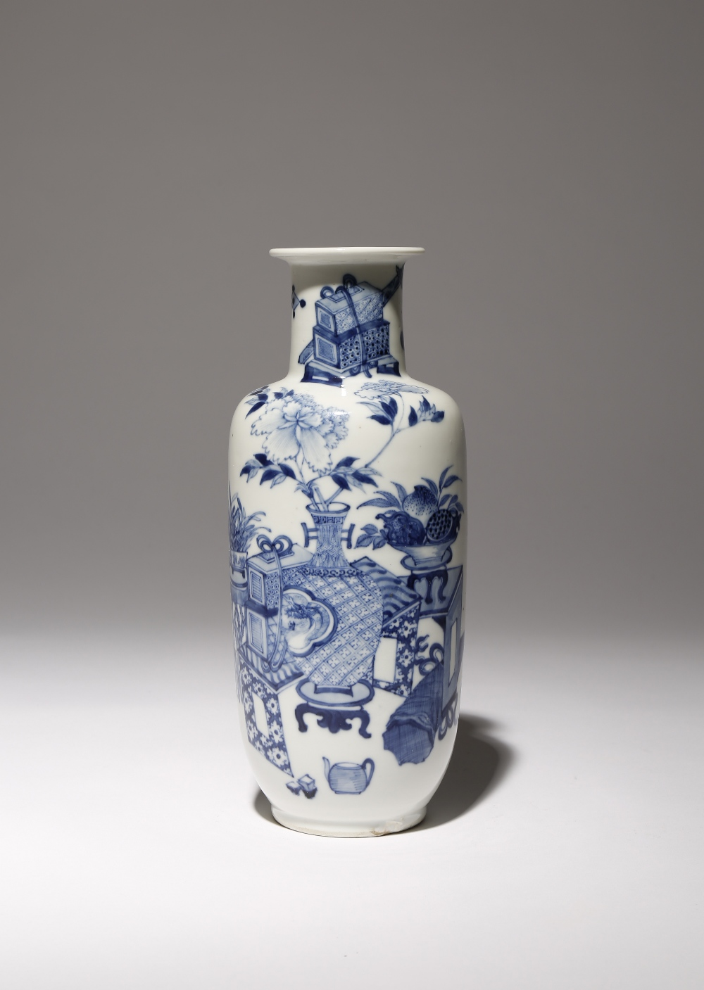 A CHINESE BLUE AND WHITE 'HUNDRED ANTIQUES' ROULEAU VASE 19TH CENTURY The tall cylindrical body