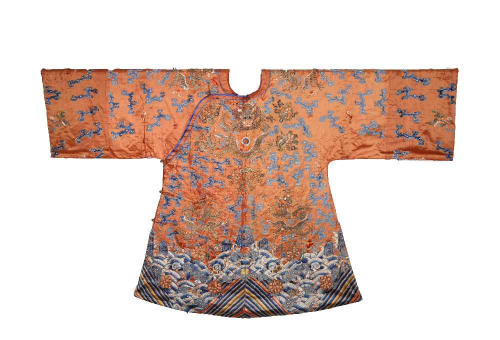 A CHINESE ORANGE-GROUND EMBROIDERED SILK 'DRAGON' ROBE LATE QING DYNASTY Embroidered in gold and
