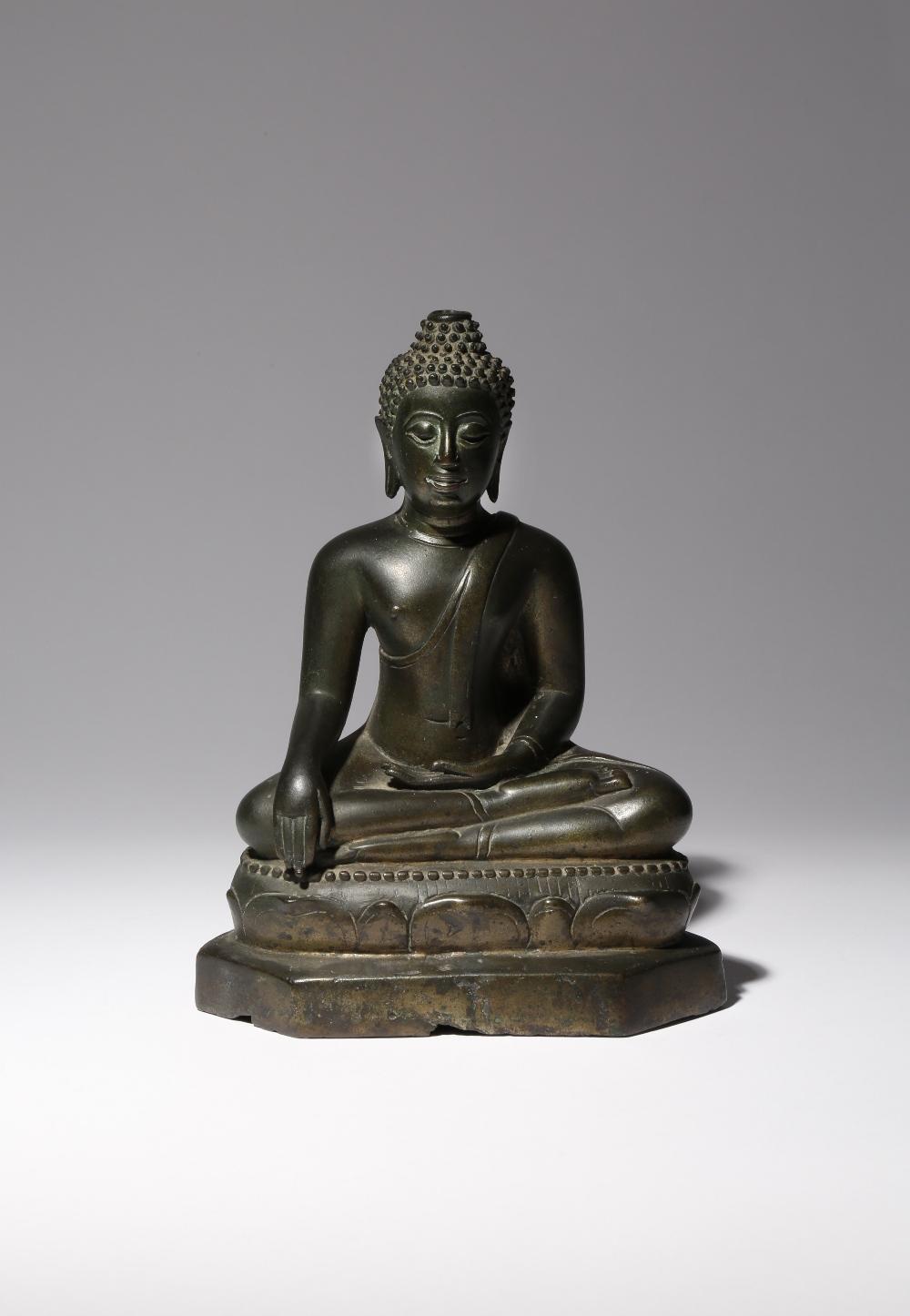 A SOUTHEAST ASIAN BRONZE FIGURE OF BUDDHA SHAKYAMUNI 19TH CENTURY He sits upon a beaded lotus throne