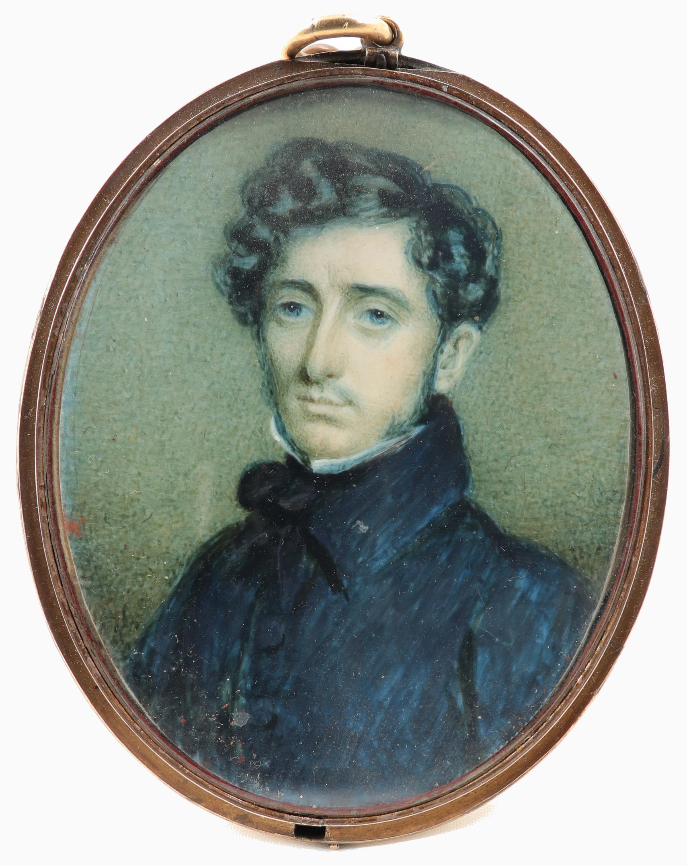 λFrench School Early 19th Century Portrait miniature of a gentleman in a black coat Oval, in a