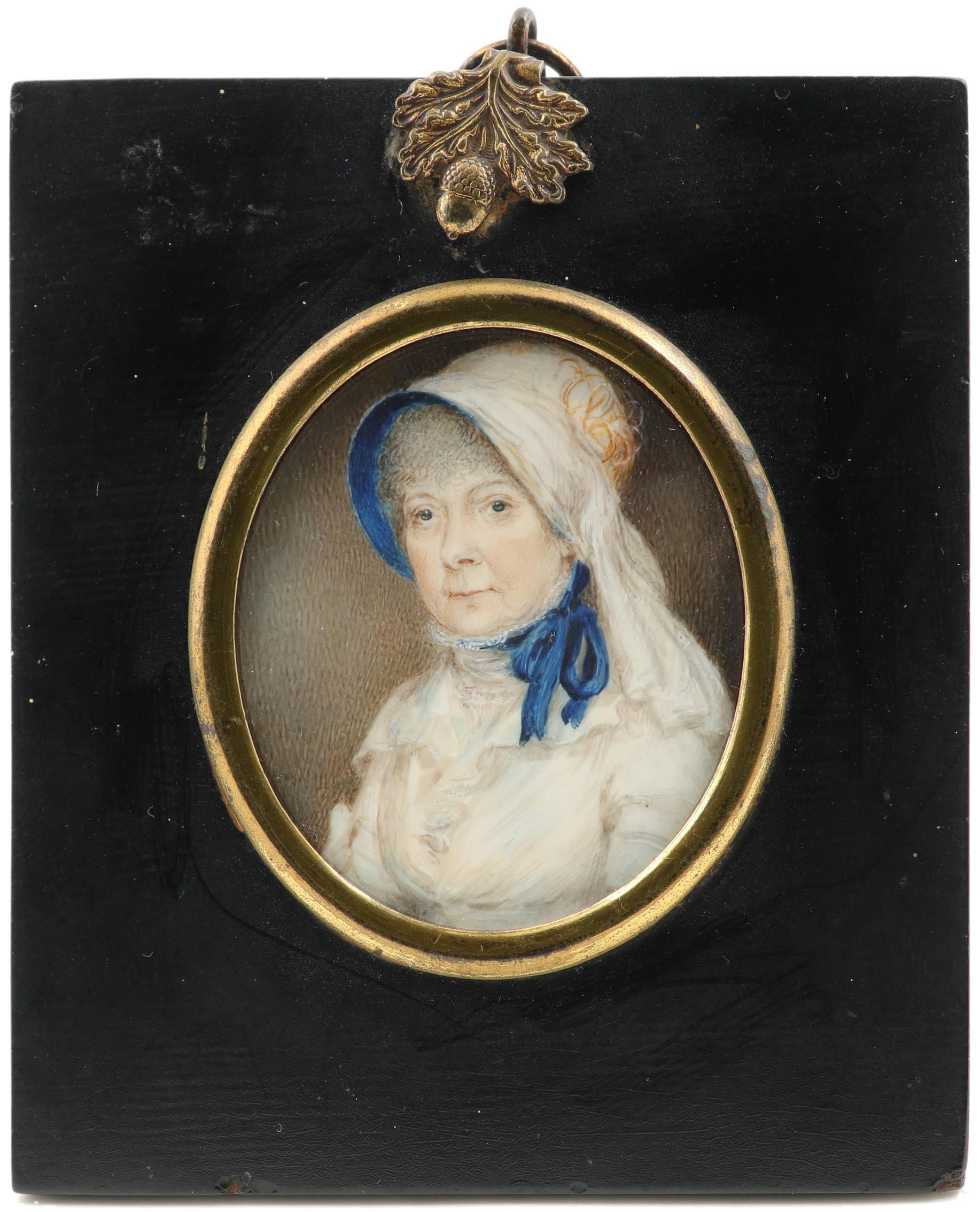 λEnglish School 19th Century Portrait miniature of a lady, wearing a white dress and blue lined - Image 2 of 3