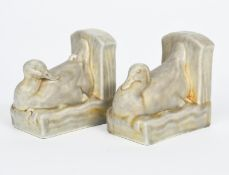 A pair of Pilkington's Royal Lancastrian Pottery bookends, each modelled as a duck swimming before