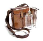 A BROWN LEATHER SANDWICH TIN AND FLASK CASE PROBABLY CAMPAIGN, EARLY 20TH CENTURY with a silver