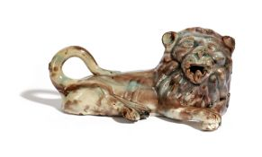 A STAFFORDSHIRE POTTERY MODEL OF A RECUMBENT LION LATE 18TH / EARLY 19TH CENTURY with a Whieldon-