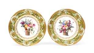 A pair of Coalport dessert plates c.1820, decorated in the manner of Nantgarw, each with a tall