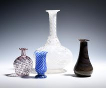 A Nailsea decanter or carafe mid 19th century, of bottle form with white striations, and three small