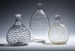 Three glass flasks late 18th/19th century, of flattened form, one Scottish and engraved to 'Ebenezer