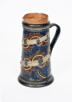 A Doulton Lambeth stoneware jug probably by George Tinworth, tapering cylindrical form, incised with
