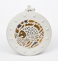 An unusual Sunflower Pottery wall plaque by Sir Edmund Elton, circular, modelled in low relief