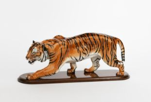 'Stalking Tiger' HN2646 a Royal Doulton figure, painted in colours, with wooden stand, printed and