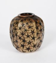 A Martin Brothers stoneware gourd vase by Edwin and Walter Martin, ovoid ribbed form, painted with
